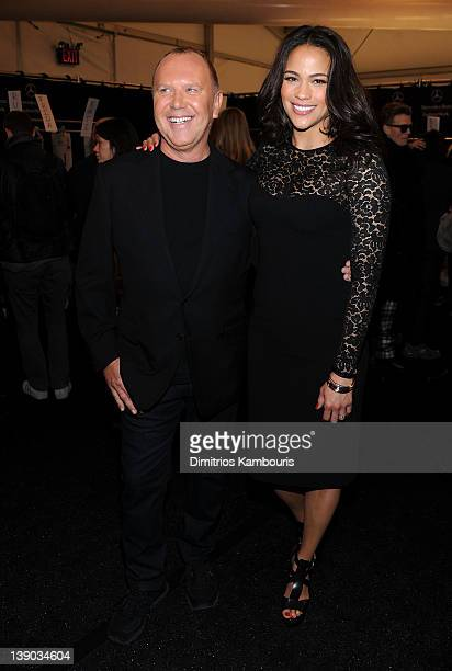 Designer Michael Kors and actress Paula Patton poses backstage at the Michael Kors Fall 2012 fashion show during MercedesBenz Fashion Week at The...