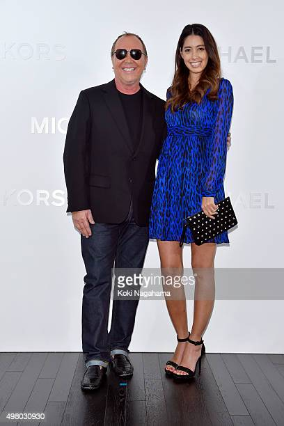 Designer Michael Kors and actress/model Izumi Mori attend the opening event for the Michael Kors Ginza Flagship Store on November 20 2015 in Tokyo...