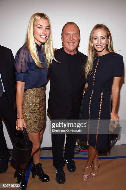 Designer Michael Kors and guests backstage at the Michael Kors Spring 2017 Runway Show during New York Fashion Week at Spring Studios on September 14...