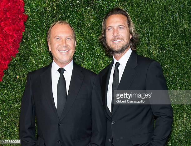 Designer Michael Kors and Lance LePere attend the 2014 God's Love We Deliver Golden Heart Awards at Spring Studios on October 16 2014 in New York City