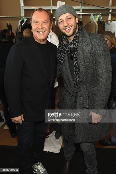 Designer Michael Kors and Lance LePere pose backstage at the Michael Kors fashion show during MercedesBenz Fashion Week Fall 2015 at Spring Studios...