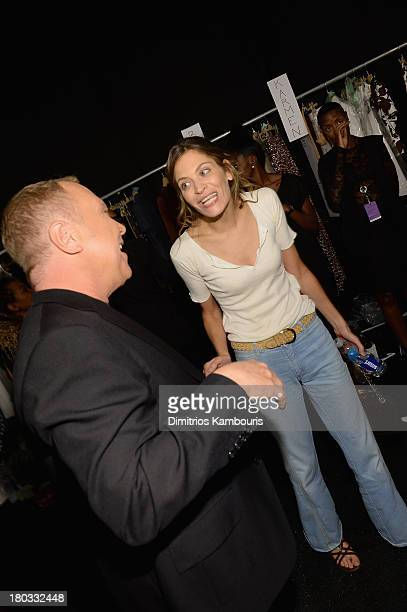 Designer Michael Kors and model Frankie Rayder backstage at the Michael Kors fashion show during MercedesBenz Fashion Week Spring 2014 at The Theatre...