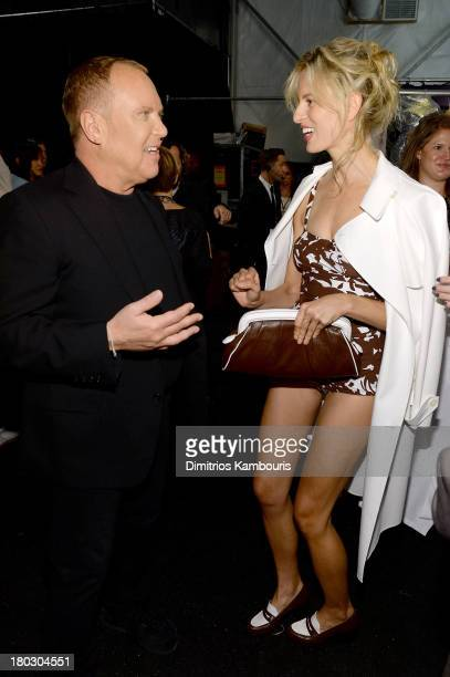 Designer Michael Kors and model Karolina Kurkova pose backstage at the Michael Kors fashion show during MercedesBenz Fashion Week Spring 2014 at The...