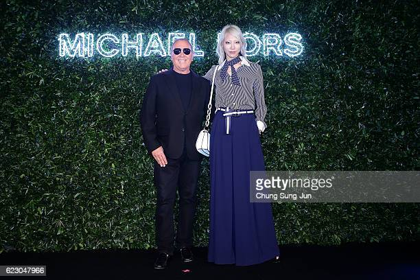 Designer Michael Kors and model Soo Joo attend the Michael Kors Young Korea Party in Seoul on November 12 2016 in Seoul South Korea