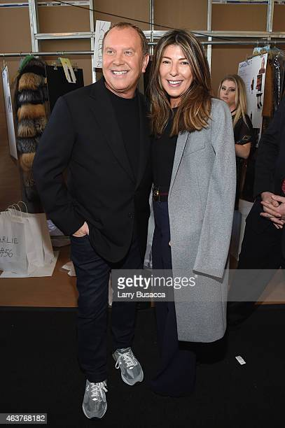 Designer Michael Kors and Nina Garcia pose backstage at the Michael Kors fashion show during MercedesBenz Fashion Week Fall 2015 at Spring Studios on...