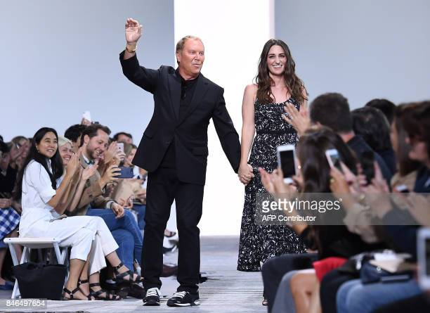 Designer Michael Kors and singer Sara Bareilles acknowledge the audience at the Michael Kors Collection Spring 2018 Runway Show at Spring Studios on...