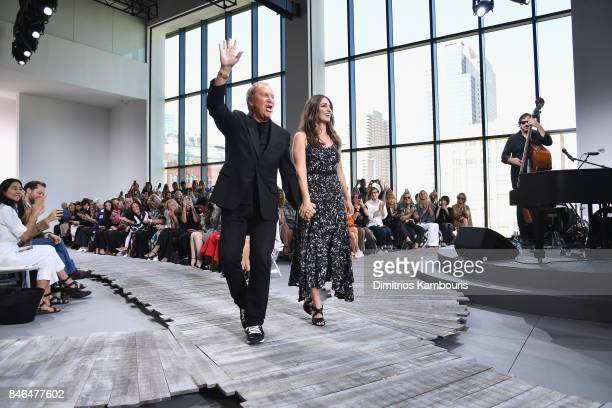 Designer Michael Kors and singer Sara Bareilles walk the runway at the Michael Kors Collection Spring 2018 Runway Show at Spring Studios on September...