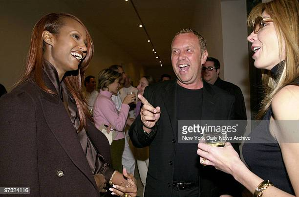 Designer Michael Kors draws smiles from model Iman and actress Natasha Richardson at a luncheon showing of his Celine spring collection at the Ace...