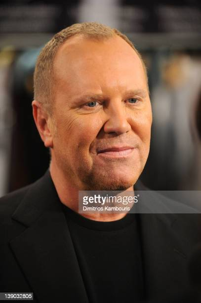 Designer Michael Kors poses backstage at the Michael Kors Fall 2012 fashion show during Mercedes-Benz Fashion Week at The Theatre at Lincoln Center...