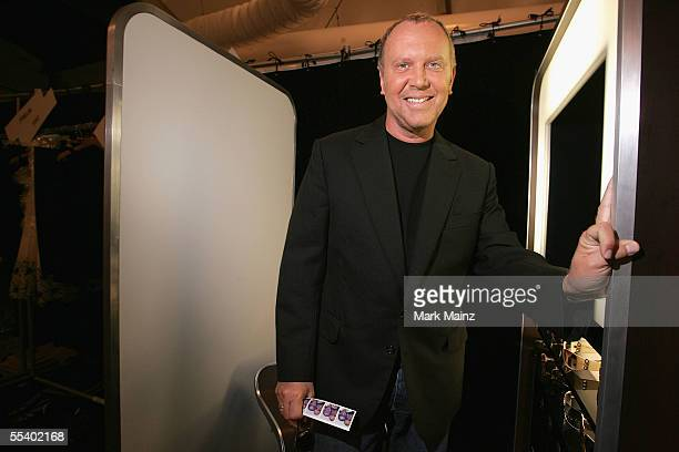 Designer Michael Kors poses backstage at the Michael Kors Spring 2006 fashion show during Olympus Fashion Week at the New York Public Library...