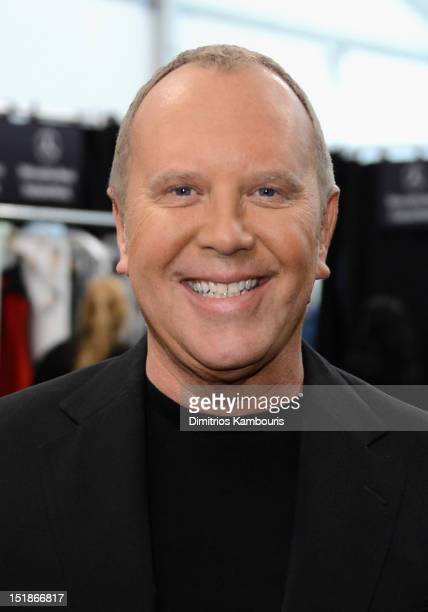 Designer Michael Kors poses backstage at the Michael Kors Spring 2013 fashion show during MercedesBenz Fashion Week at The Theatre at Lincoln Center...