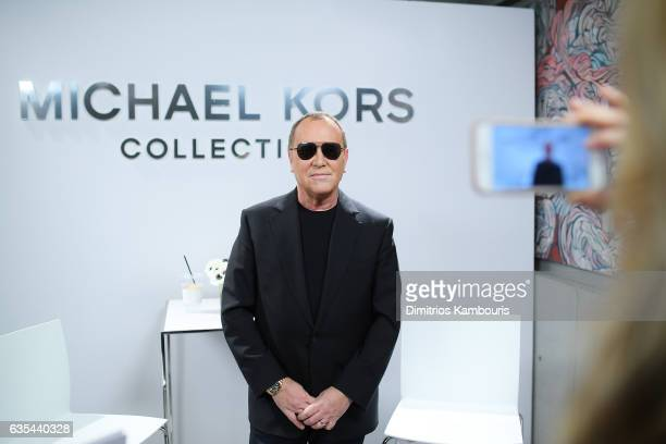 Designer Michael Kors poses backstage before the Michael Kors Collection Fall 2017 runway show at Spring Studios on February 15 2017 in New York City