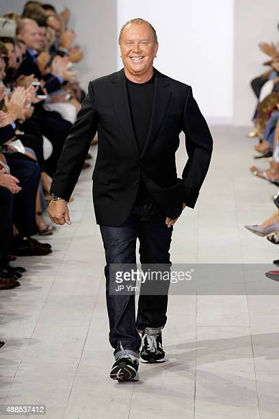 Designer Michael Kors poses on the runway at the Michael Kors Spring 2016 Runway Show during New York Fashion Week The Shows at Spring Studios on...