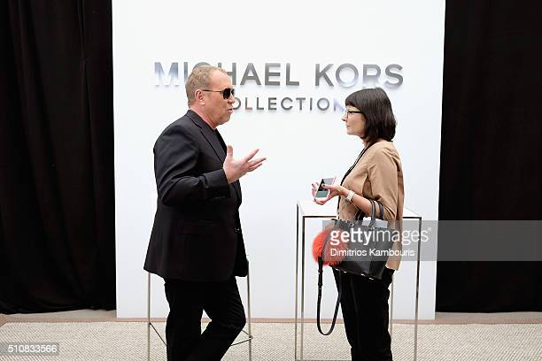 Designer Michael Kors prepares backstage at the Michael Kors Fall 2016 Runway Show during New York Fashion Week The Shows at Spring Studios on...