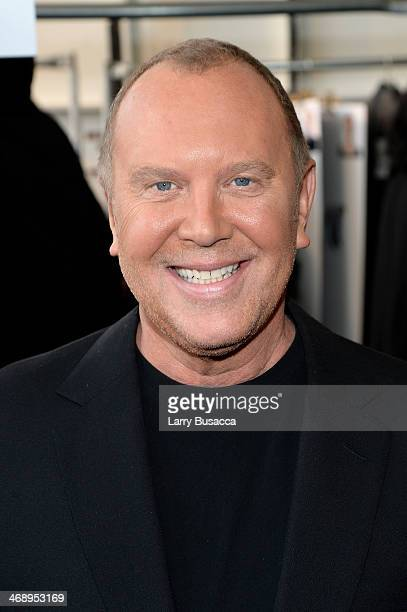 Designer Michael Kors prepares backstage at the Michael Kors fashion show during Mercedes-Benz Fashion Week Fall 2014 at Spring Studios on February...