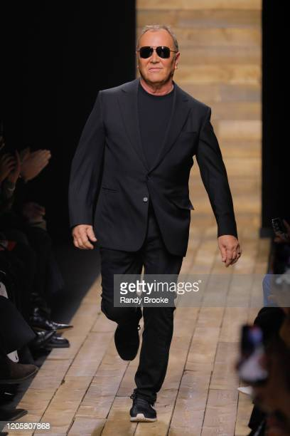Designer Michael Kors races around the runway after his Michael Kors FW 2020 fashion show at the American Stock Exchange on February 12 2020 in New...