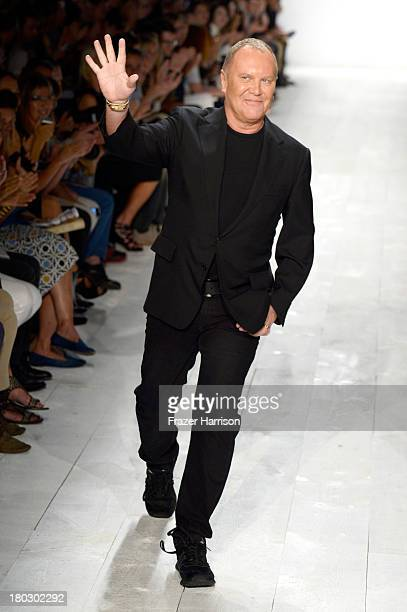 Designer Michael Kors walks the runway at the Michael Kors fashion show during MercedesBenz Fashion Week Spring 2014 at The Theatre at Lincoln Center...