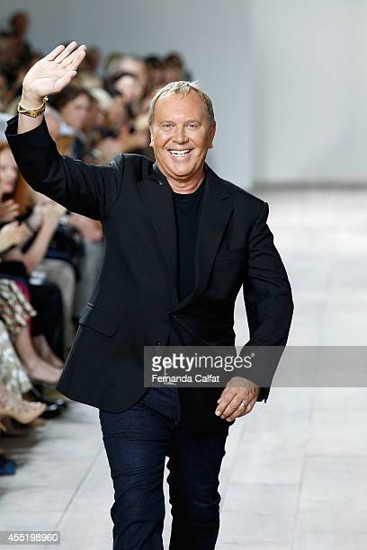 Designer Michael Kors walks the runway at the Michael Kors fashion show during MercedesBenz Fashion Week Spring 2015 at Spring Studios on September...