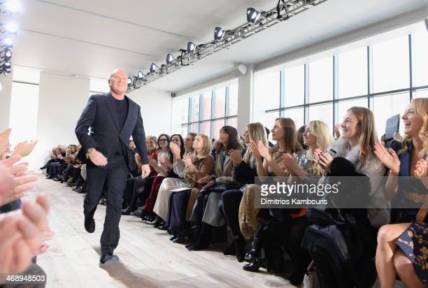 Designer Michael Kors walks the runway at the Michael Kors fashion show during MercedesBenz Fashion Week Fall 2014 at Spring Studios on February 12...