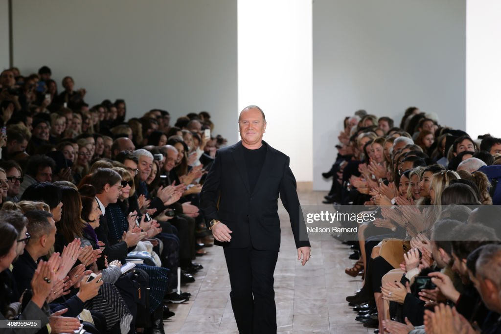 Designer Michael Kors walks the runway at the Michael Kors fashion show during Mercedes-Benz Fashion Week Fall 2014 at Spring Studios on February 12, 2014 in New York City.