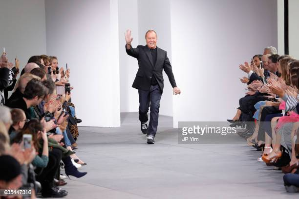 Designer Michael Kors walks the runway during the Michael Kors Collection Fall 2017 fashion show at Spring Studios on February 15 2017 in New York...
