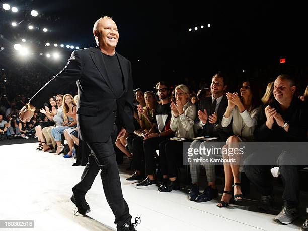Designer Michael Kors walks the runway during the Michael Kors fashion show during MercedesBenz Fashion Week Spring 2014 at The Theatre at Lincoln...