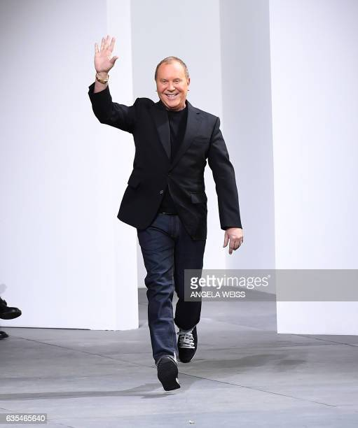 Designer Michael Kors walks the runway for the Michael Kors collection during New York Fashion Week on February 15 in New York City / AFP / Angela...