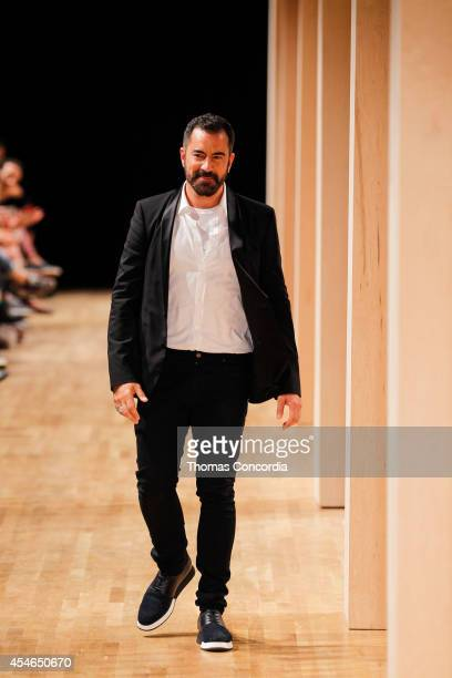 Designer Michael Maccari walks the runway after showing the Perry Ellis Spring 2015 Collection during MercedesBenz Fashion Week Spring 2015 on...