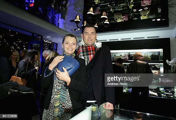 Designer Michael Michalsky and actress AnneSophie Briest attend the preChristmas reception at MCM store on December 7 2009 in Berlin Germany