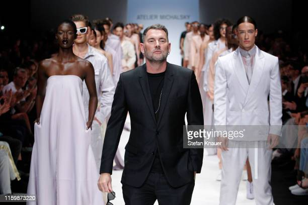 Designer Michael Michalsky and models acknowledge the applause of the audience after the Atelier Michalsky show during the Berlin Fashion Week...