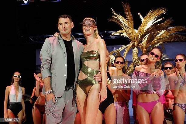 Designer Michael Michalsky poses with his models at the end of the 'Michalsky StyleNite' show during MercedesBenz Fashion Week Berlin Spring/Summer...