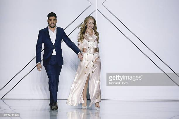 Designer Michael Russo and Tamara Ralph aknowledge the audience during the Ralph Russo Spring Summer 2017 show at the Grand Palais as part of Paris...