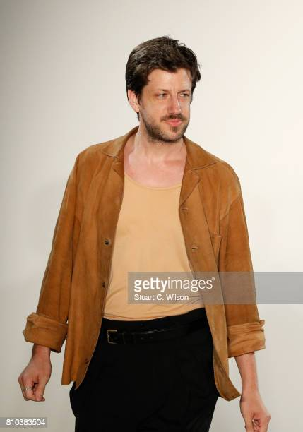 Designer Michael Sontag acknowledges the applause of the audience at the Michael Sontag show during the MercedesBenz Fashion Week Berlin...