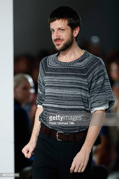 Designer Michael Sontag acknowledges the audience following his show during the MercedesBenz Fashion Week Berlin A/W 2017 at Kaufhaus Jandorf on...