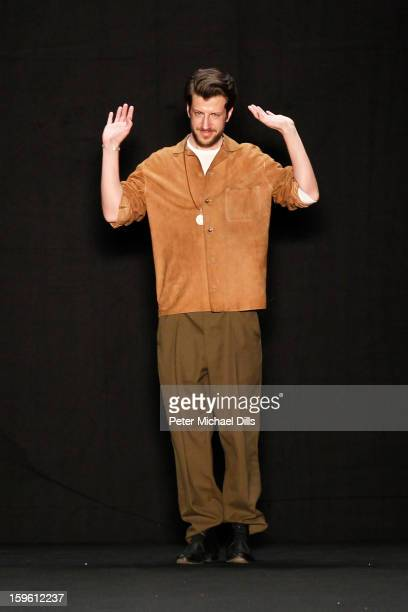 Designer Michael Sontag takes the applause at Michael Sontag Autumn/Winter 2013/14 fashion show during Mercedes-Benz Fashion Week Berlin at...
