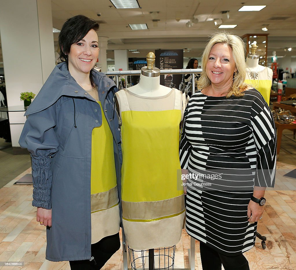 Designer Michelle Franklin and Sr. VP and General Merchandise Manager MaryAnn Morin pose with Michelle's Project Runway Lord & Taylor challenge winning design during an in-store visit at the Lord & Taylor Flagship store on March 22, 2013 in New York City.