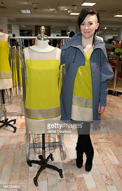 1b36b7dec16 Designer Michelle Franklin poses with her Project Runway Lord Taylor  challenge winning design during an instore