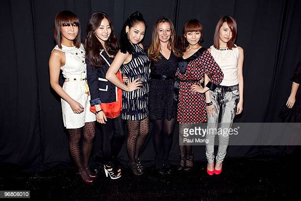 Designer Michelle Smith poses with The Wonder Girls backstage at Milly By Michelle Smith Fall 2010 during MercedesBenz Fashion Week at Bryant Park on...