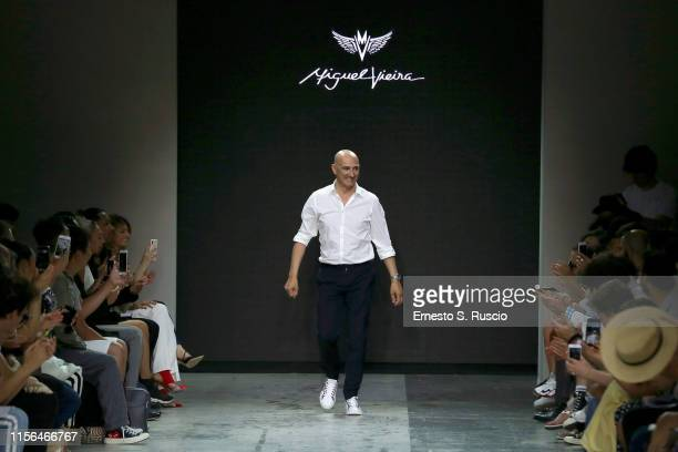 Designer Miguel Vieira acknowledges the applause of the audience after his fashion show during the Milan Men's Fashion Week Spring/Summer 2020 on...