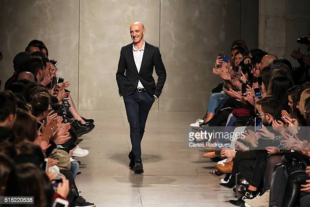 Designer Miguel Vieira acknowledges the audience after his show during Lisboa Fashion Week Autumn/Winter 2016/2017 in Lisbon on March 12 2016 in...
