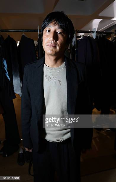 Designer Mihara Yasuhiro backstage ahead of the Maison MIHARA YASUHIRO during London Fashion Week Men's January 2017 collections at Barbican Centre...