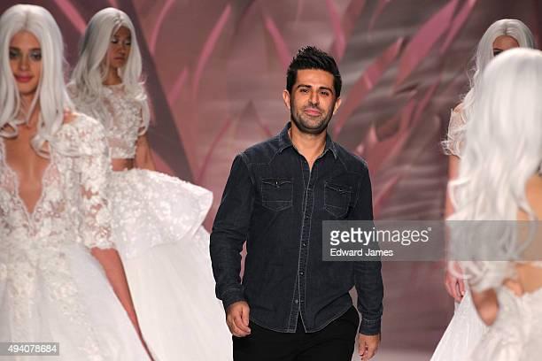 Designer Mikael D walks the runway at the Mikael D Spring/Summer 2016 fashion show during World Mastercard fashion week on October 23 2015 at David...
