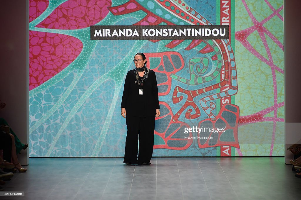 Designer Miranda Konstantinidou walks the runway at the Miranda Konstantinidou show during the Mercedes-Benz Fashion Week Spring/Summer 2015 at Erika Hess Eisstadion on July 11, 2014 in Berlin, Germany.