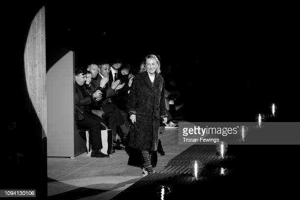Designer Miuccia Prada acknowledges the applause of the audience at the Prada show during Milan Men's Fashion Week Autumn/Winter 2019/20 on January...