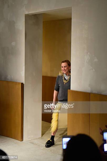 Designer Miuccia Prada acknowledges the applause of the audience at the Prada show during Milan Men's Fashion Week Fall/Winter 2017/18 on January 15...