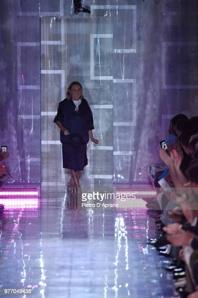 Designer Miuccia Prada acknowledges the applause of the audience at the Prada show during Milan Men's Fashion Week Spring/Summer 2019 on June 17 2018...