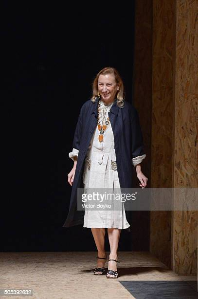 Designer Miuccia Prada acknowledges the audience at the end of the Prada show during Milan Men's Fashion Week Fall/Winter 2016/17 on January 17, 2016...