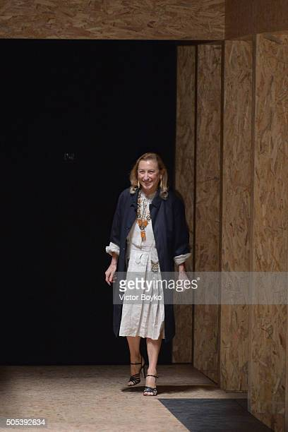 Designer Miuccia Prada acknowledges the audience at the end of the Prada show during Milan Men's Fashion Week Fall/Winter 2016/17 on January 17 2016...