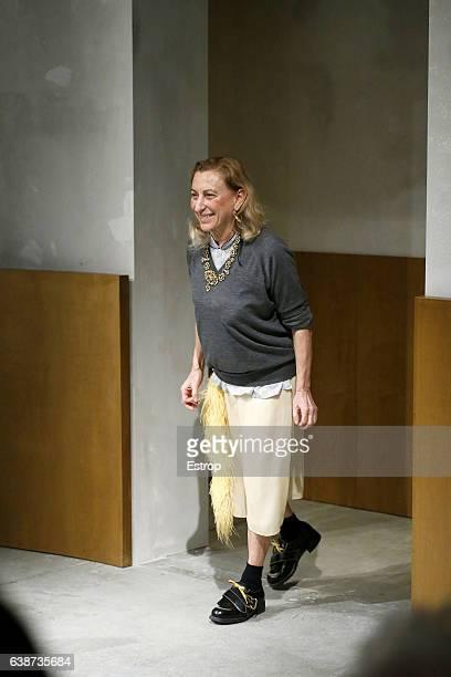 Designer Miuccia Prada walks the runway at the Prada designed by Miuccia Prada show during Milan Men's Fashion Week Fall/Winter 2017/18 on January...