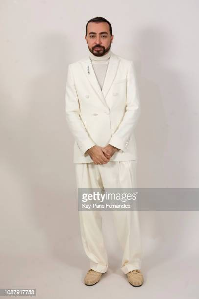 Designer Mohammed Ashi poses backstage prior the Ashi Studio Spring Summer 2019 show as part of Paris Fashion Week on January 23 2019 in Paris France
